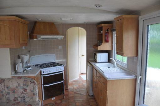 Caravane à vendre 2 chambres sur emplacement dans un camping en Ardenne